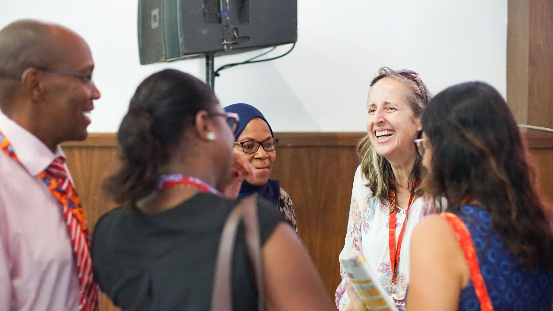 Dr. Trish Scanlan in conversation with panel audience members at the AORTIC conference in Maputo. (Noah Smith/ Direct Relief)