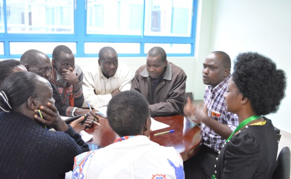 Dr. Asirwa leads a Community Health Workers focus group meeting as part of the Lung Cancer Control program. (Photo Courtesy of Fredrick Chite Asirwa),