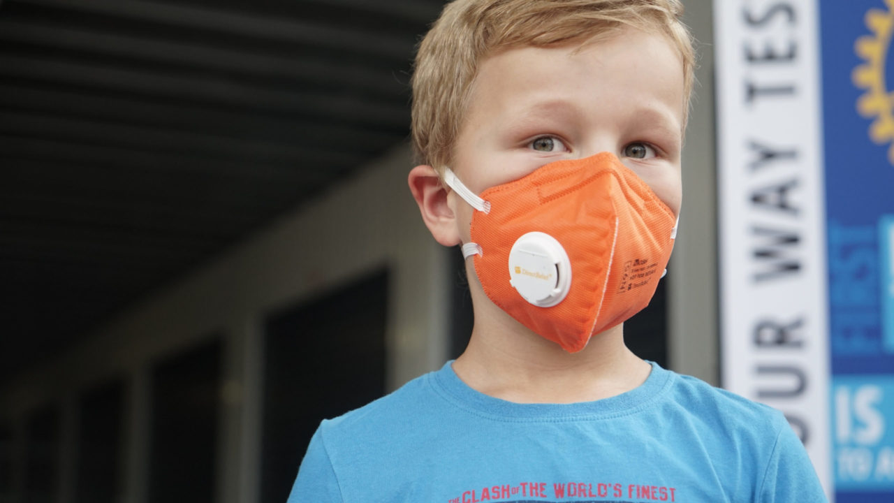 Children in Picton, New South Wales, try on masks on Jan. 16, 2020. The area has been seriously impacted by bushfires and 30 homes have been lost in the surrounding area since Oct. 2019. 37,500 N95 masks (equivalent to P2) were distributed in Picton Jan. 16, 2020, in coordination with the Rural Fire Service, which directed 15,000 for their crews and the public, and 12,500 to Picton Rotary, who will be distributing to the public. (Lara Cooper/Direct Relief)