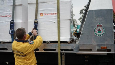 Firefighter Kurt Hill of Albion Park Rural Fire Service loads 15,000 masks on Jan. 16, 2020, in Picton, New South Wales, Australia. The masks would go to fire crews and community members still enduring poor air quality. (Lara Cooper/Direct Relief)