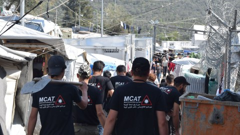Members of the Moria Corona Awareness Team conduct outreach in the camp. (Photo by Muhannad Al Mandil)