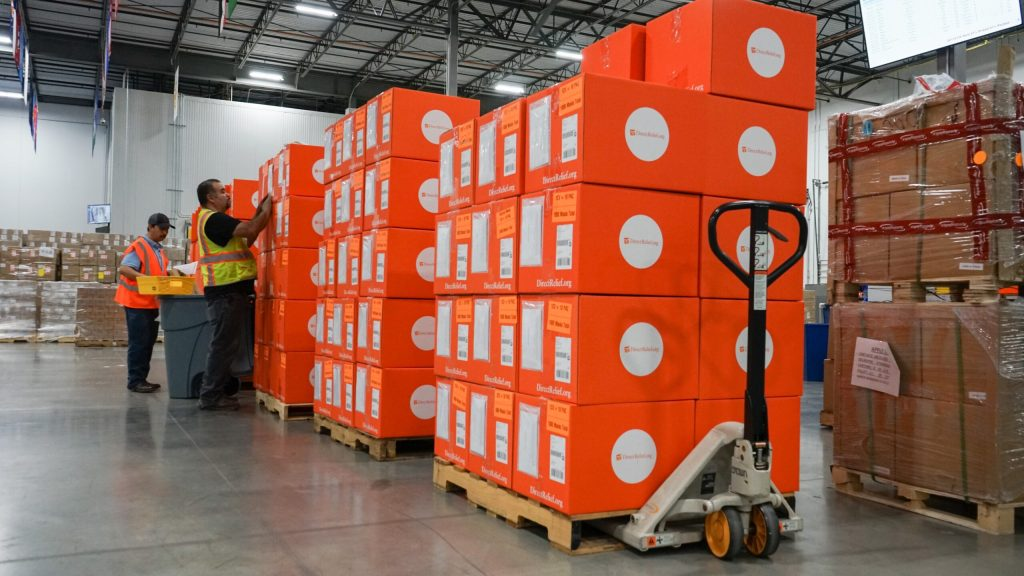 More than 1,000 shipments of protective gear are prepped for shipment in Direct Relief's warehouse on May 7, 2020, in response to the Covid-19 outbreak. (Lara Cooper/Direct Relief)