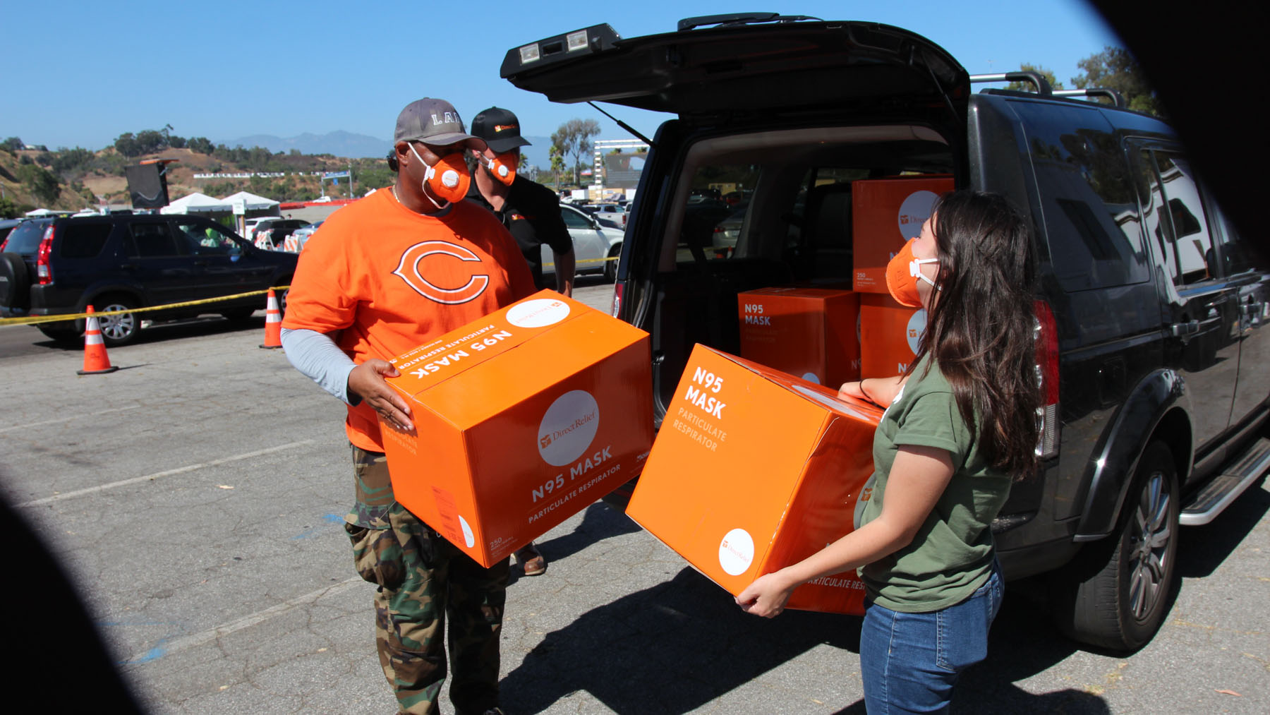 CORE responders carry N95 masks for volunteers at Dodger Stadium, donated by Direct Relief. (Noah Smith/Direct Relief)