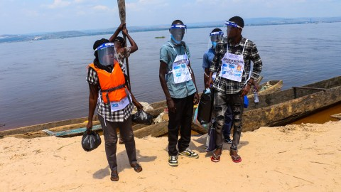 A team of Community Health Workers arrive on Dilolo Island in the Democratic Republic of Condo. The team has donated PPE from CAF-Africa.
