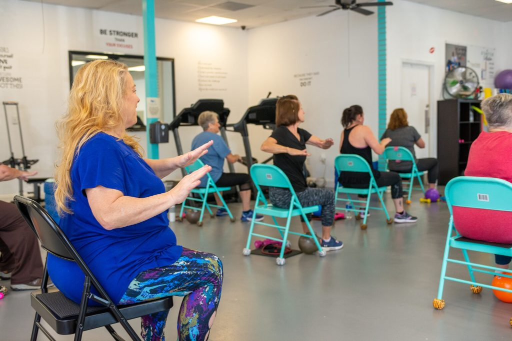 A Healthier You Meridian participant, Jo Ellen Reeves, participates in a weekly chair fitness class at a local women's gym. Meridian, MS Tues, Nov. 24, 2020 (Photo By Revere Photography for Direct Relief)