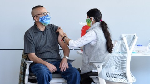 A patient is immunized at Direct Relief on Saturday. (Photo by Mike Eliason for Direct Relief)