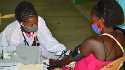 A midwifery student with a patient. (Photo courtesy of Midwives for Haiti)