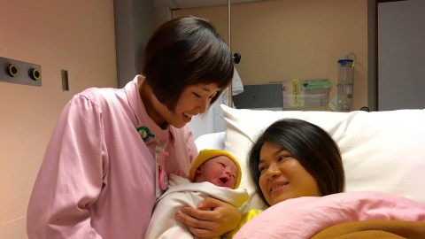A midwife cares for a mother and baby. (Courtesy photo)