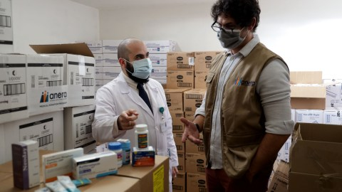 Christian Sawma (pictured, left), head pharmacist at Lebanese American University's Medical Center, with donated medical aid earlier this year via Anera. Anera Lebanon received $3.2 million in donated medical aid from Direct Relief over the past seven days, and those shipments included respiratory and immune system therapies. (Courtesy photo)