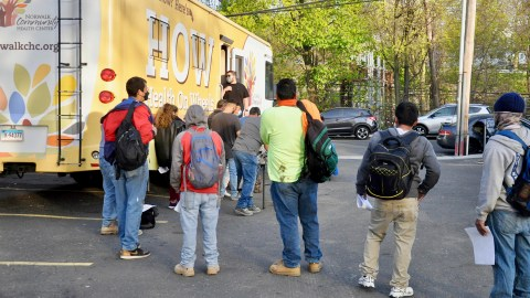 Day laborers wait for a vaccine at Norwalk Community Health Center's mobile medical unit. (Photo courtesy of Norwalk Community Health Center)