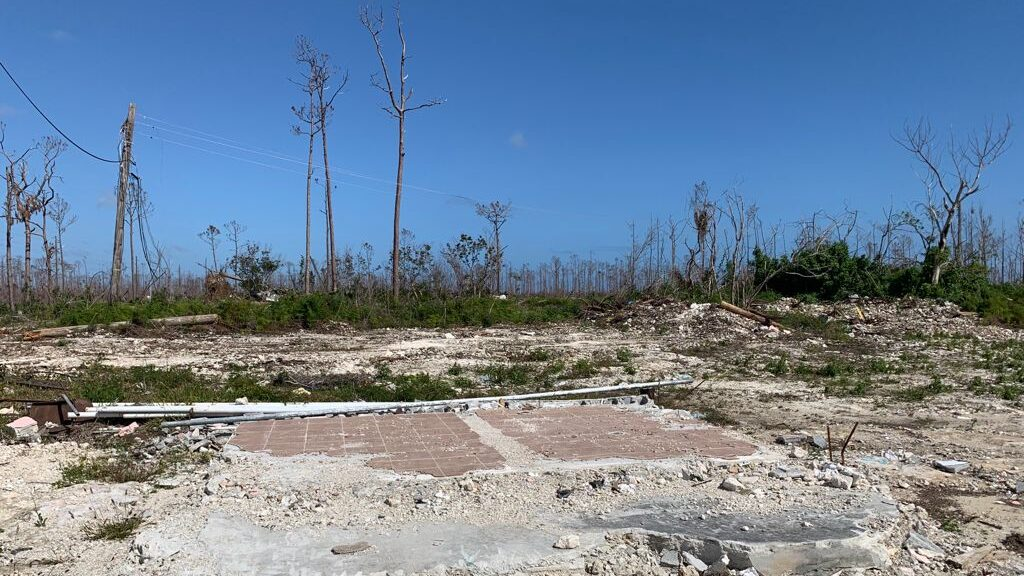 The site of the clinic in High Rock after clearing of initial debris. The lack of leaves on the trees illustrates the sheer force of wind that came with Dorian. (Photo by Rob Sweeting/Direct Relief)