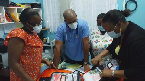 Healthcare professionals in Dominica unpack emergency medical supplies deployed by Direct Relief in response to Covid-19. As of June 2020, the island nation had reported a total of 18 coronavirus cases since closing its borders in March. With only one public hospital, the country acted preemptively to prevent a large-scale outbreak of the virus. (Dr. Laura Espirit/Dominica Ministry of Health)