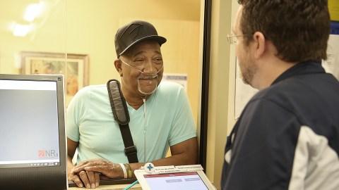 A patient picks up a prescription at St. Vincent de Paul Charitable Pharmacy in Cincinnati, Ohio. (Photo courtesy of SVDP)