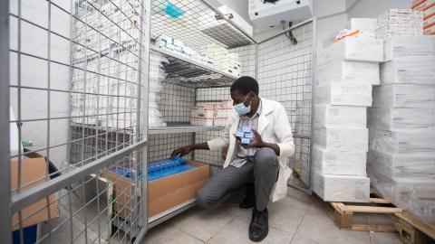 19 April 2021 - Muhimbili National Hospital, Paediatric Block, Dar es Salaam, Tanzania - Ezekiel Tunduje, a pharmacist, organizing drugs in a cold room at Muhimbili Hospital built through donations from Direct Relief through Tumaini La Maisha.