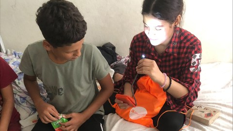 Children newly arrived to Turkey from Afghanistan receive hygiene kits from Direct Relief, delivered via Reach Out Worldwide, which was also using Emergency Medical Backpacks to provide triage care in Turkey. (Reach Out Worldwide photo)