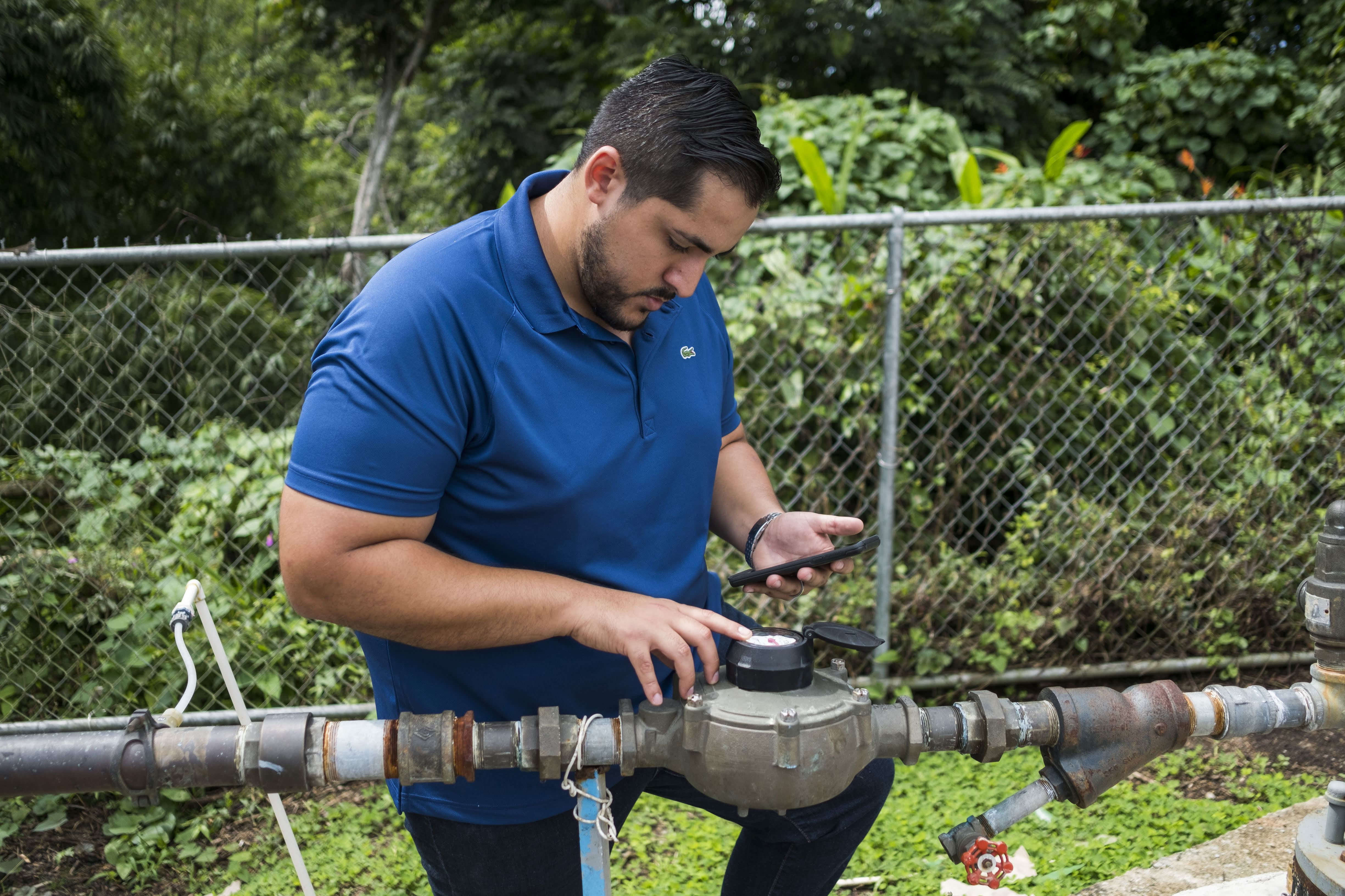 Tuesday November 6, 2018 / Yabucoa, Puerto Rico/Alex Rodriguez, a young PHD candidate from Canovanas Puerto Rico, works at the Tejas community in Yabucoa, installing solar panels to provide power to the community water pump system. Direct Relief is committed to provide clean water to non-PRASA communities in the Island. After Hurricane Maria. Photo: Dennis M. Rivera Pichardo for Direct Relief