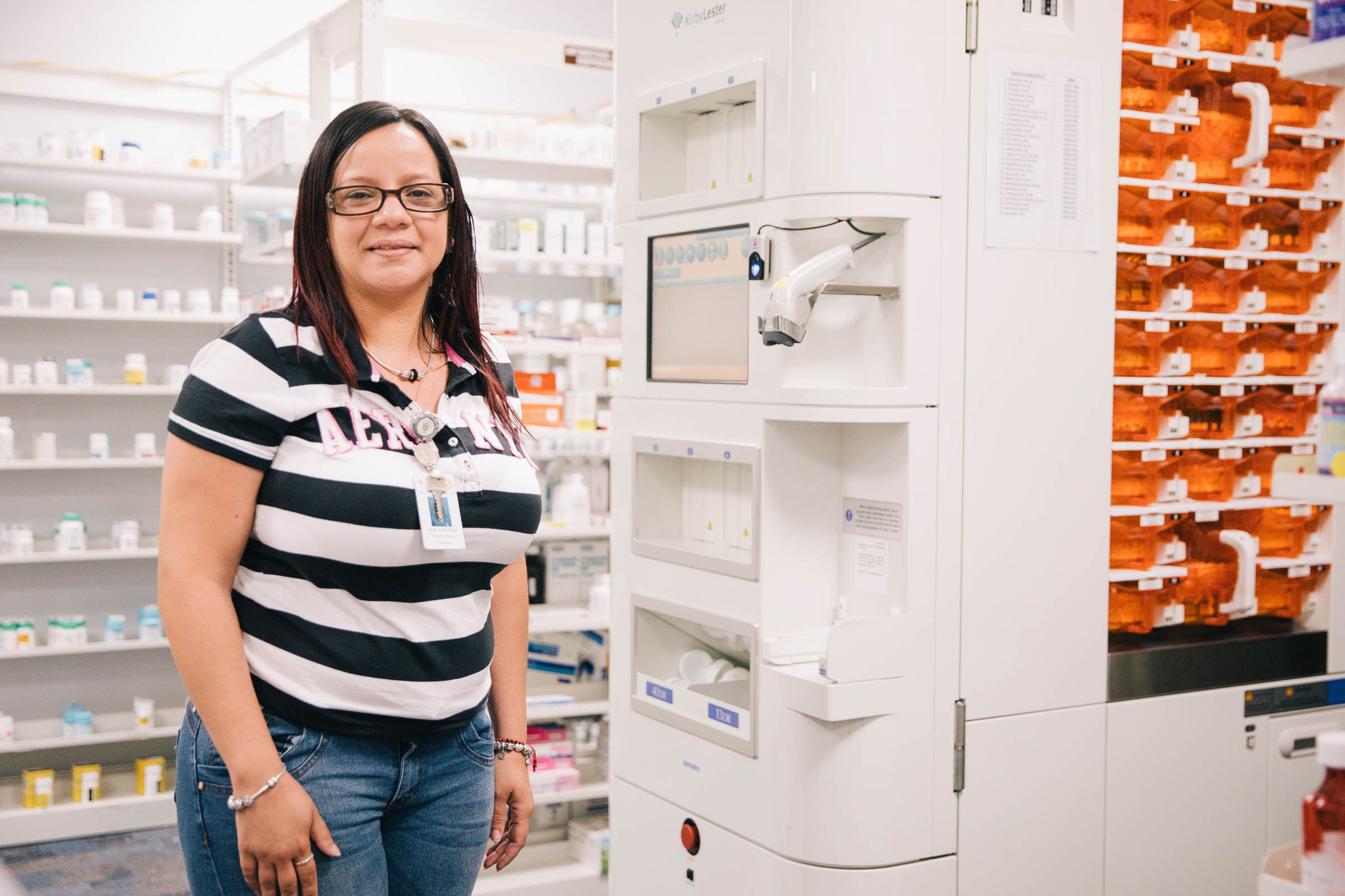 Morovis Community Health Center Nydia Torres in the center's pharmacy on Dec. 17, 2017. The center stopped treating patients before, during or after Hurricane Maria made landfall, even when the center's glass doors were destroyed by 150 mile-per-hour winds. Clinical staff were able to barricade the doors with plywood and the clinic kept operating. (Photo by Donnie Hedden for Direct Relief)