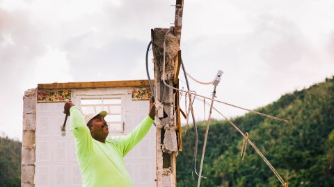 Pedro Luis Ortiz built his home in Arroyo, Puerto Rico, 27 years ago. On Dec. 18, 2017, Ortiz and his family took down what remained of the home's second floor after Hurricane Maria made landfall in the surrounding valley. (Photo by Donnie Hedden for Direct Relief)