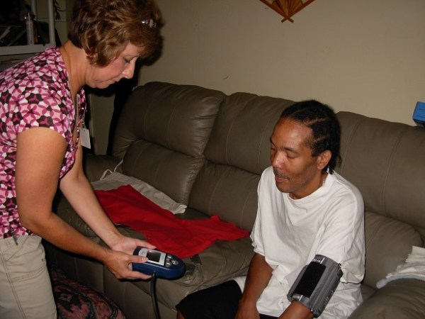 A Roanoke Chowan staffer helps a patient become familiar with the remote monitoring system. Photo courtesy of RCCHC.