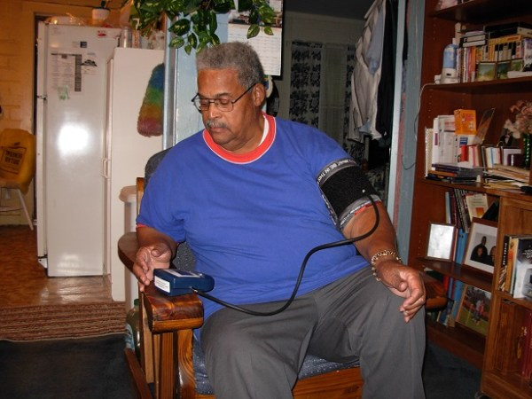 A RCCHC patient takes screenings of his health data that will be transmitted to RCCHC. Photo courtesy of RCCHC.