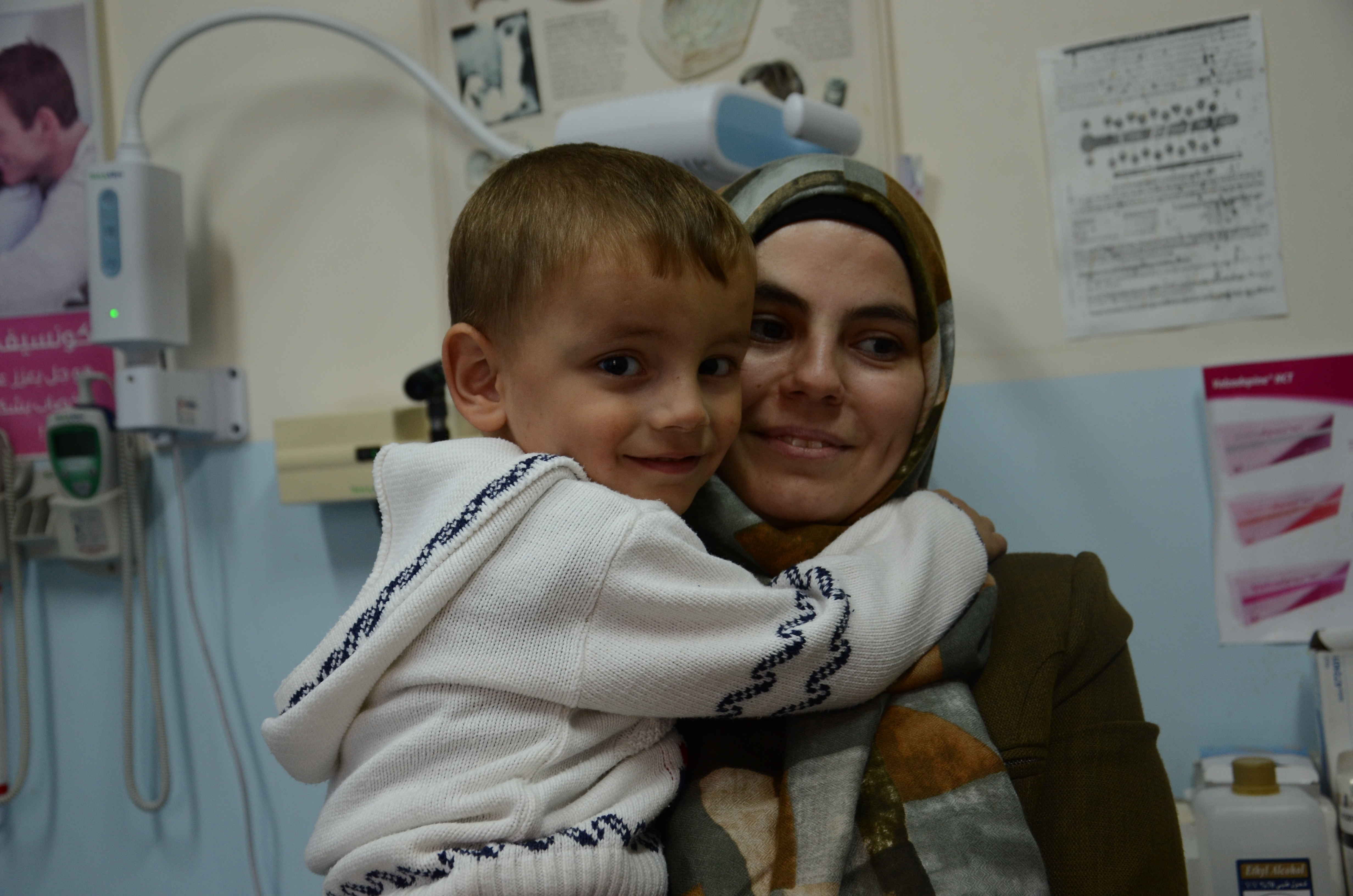 Yusa and her youngest son, Muhannad, pictured here at Hebron Charitable Medical Center. (Photo courtesy of Anera)