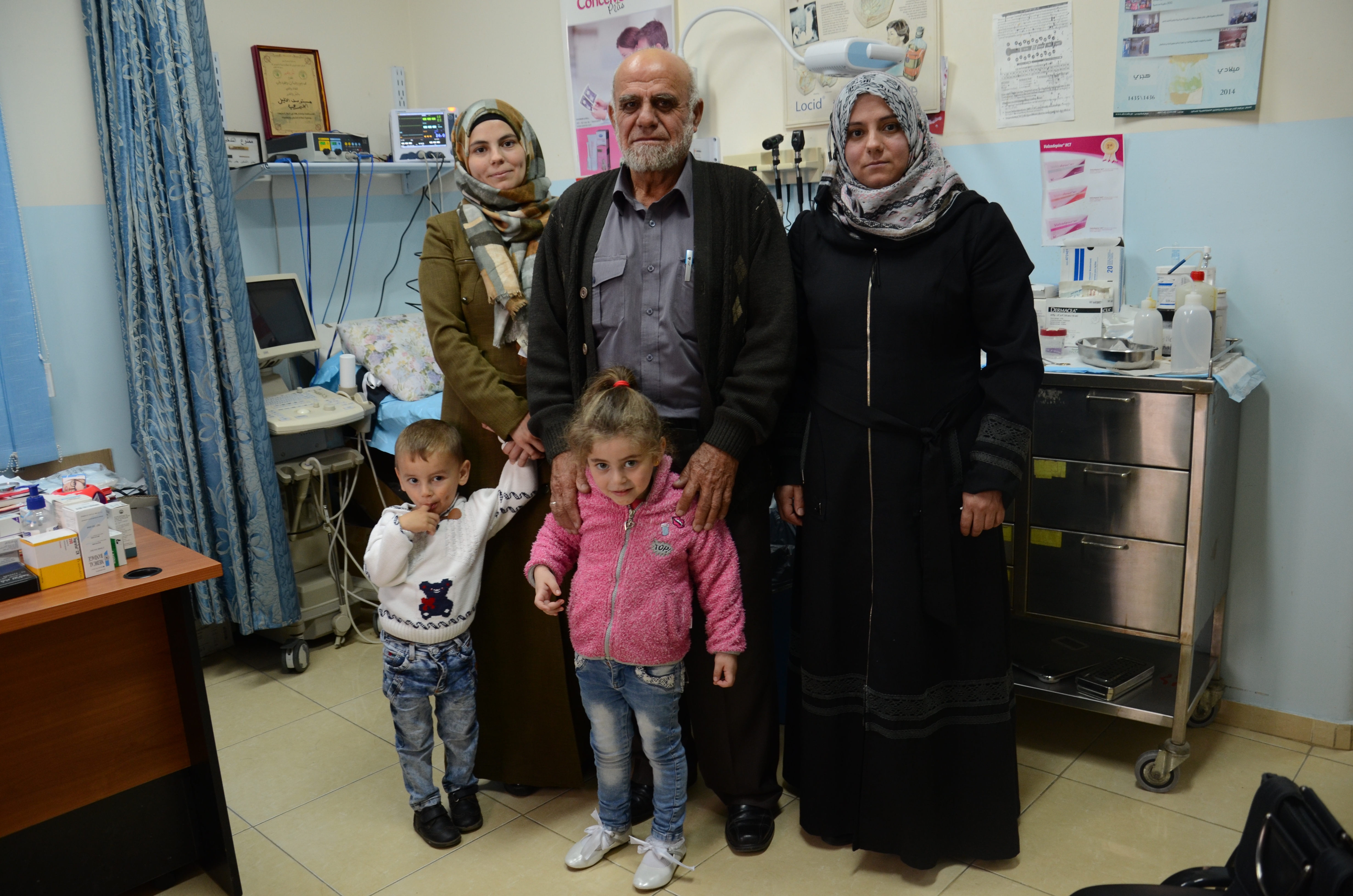 Yusra (back row, left) is pictured with her son, father, sister and niece. Hebron Charitable Medical Center is part of their 'support system.' (Photo courtesy of Anera)