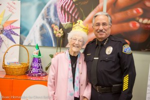 Edythe with Santa Barbara Police Chief, Cam Sanchez, who named her Honorary Police Chief for the Day. Photo by Isaac Hernandez.