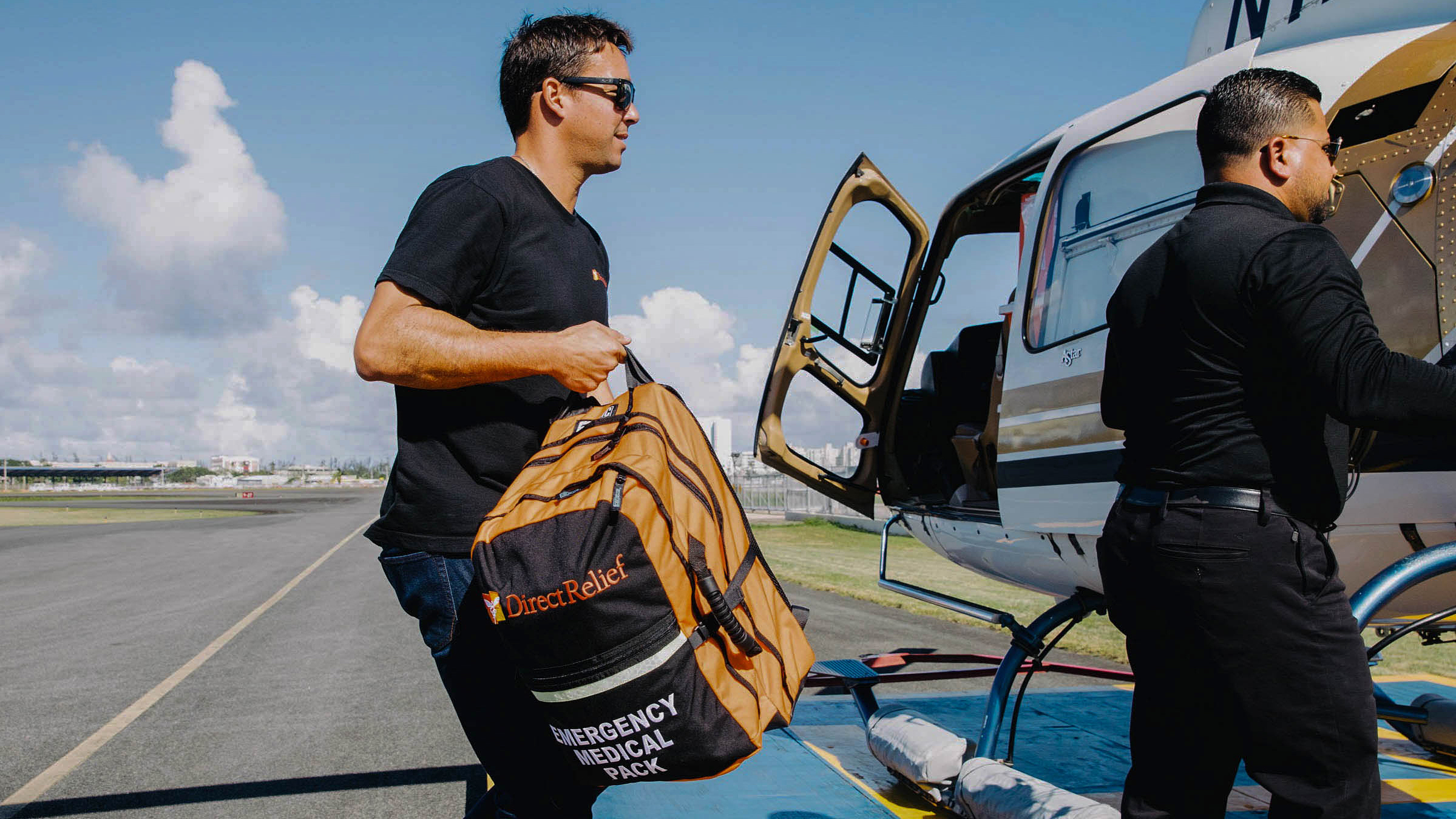 Direct Relief staff load Emergency Medical Backpacks onto a helicopter bound for Vieques, an island off Puerto Rico's eastern coast that was badly impacted by Hurricane Maria. A new agreement reached this week will put more packs in the hands of emergency first responders so they're ready in case of disaster. (Photo by Donnie Hedden for Direct Relief)