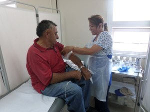 A patient is treated at a hospital that received donated supplies. Photo courtesy of FEDES.