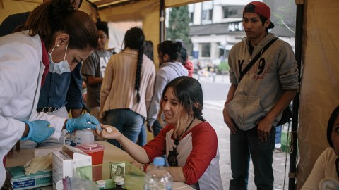 A women gets her blood glucose levels checked at a pop-up clinic in Mexico City's neighborhood of La Roma by Dr. Eduardo Juarez Oliveros. The clinic was set up by the Association Mexica de Diabetes (AMD) in partnership with Direct Relief. The clinic is aimed at serving populations in the city displaced by the earthquake, especially those with diabetes. (Photo by Meghan Dhaliwal for Direct Relief)