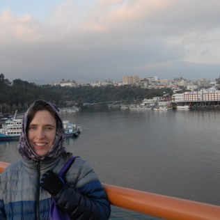 My lovely wife with Seogwipo harbor and city in the background.