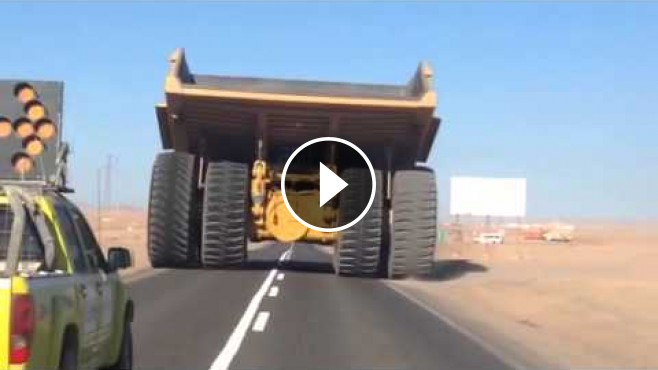 Gigantic Caterpillar 797b Rock Truck Caught On Camera
