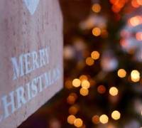 """Merry Christmas"" sign with lights."