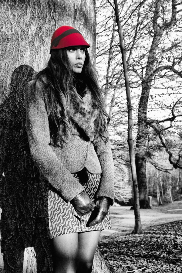 Black + white photograph- with bright pink hat