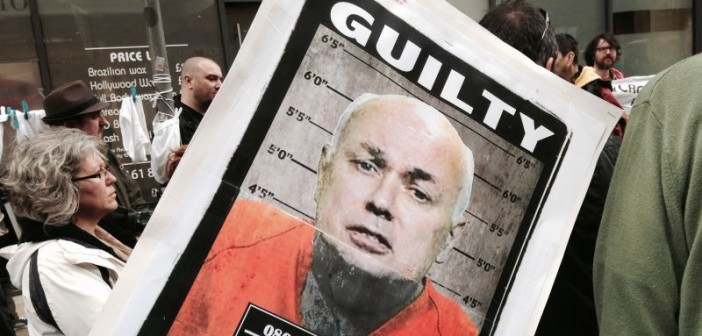 Poster with Iain Duncan Smith' in a prison outfit and the word 'guilty'