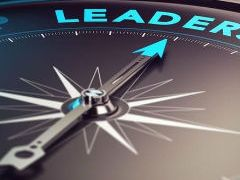 Compass with leadership at top and dial pointing it.