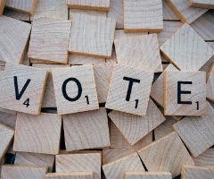 "The word, ""Vote"" on Scrabble tiles"