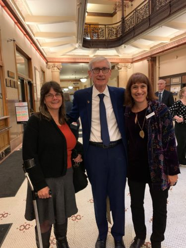 DRW staff standing with Governor Evers