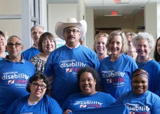 Group people posing together in Wisconsin Disability Vote Coalition t-shirts and smiling