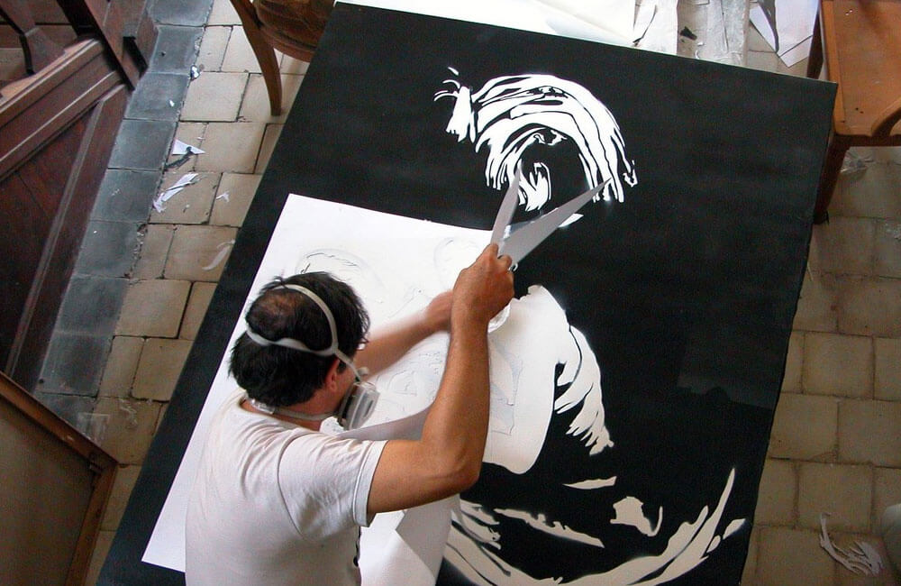 Blek-Le-Rat-Working-On-Stencil-by-isupportstreetart