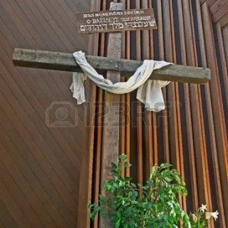 11163794-this-easter-cross-is-inside-a-church-with-a-white-cloth-draped-across-it–it-has-a-rustic-sign-writt