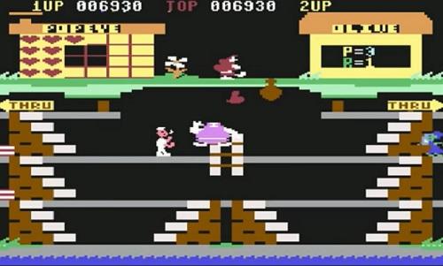 Popeye intento a raccogliere i cuori lanciati da Olive Oyl in uno dei videogiochi tratti dai fumetti degli anni 80