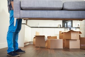 closeup of man not professional movers moving a sofa