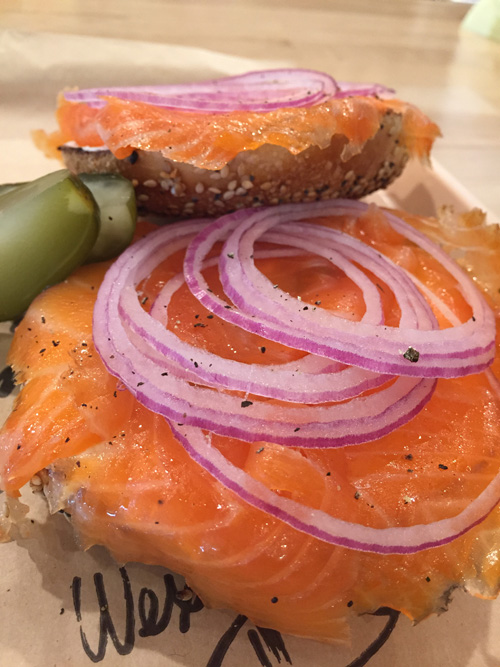 Toasted Bagel with everything, lox, cream cheese and red onions. deli