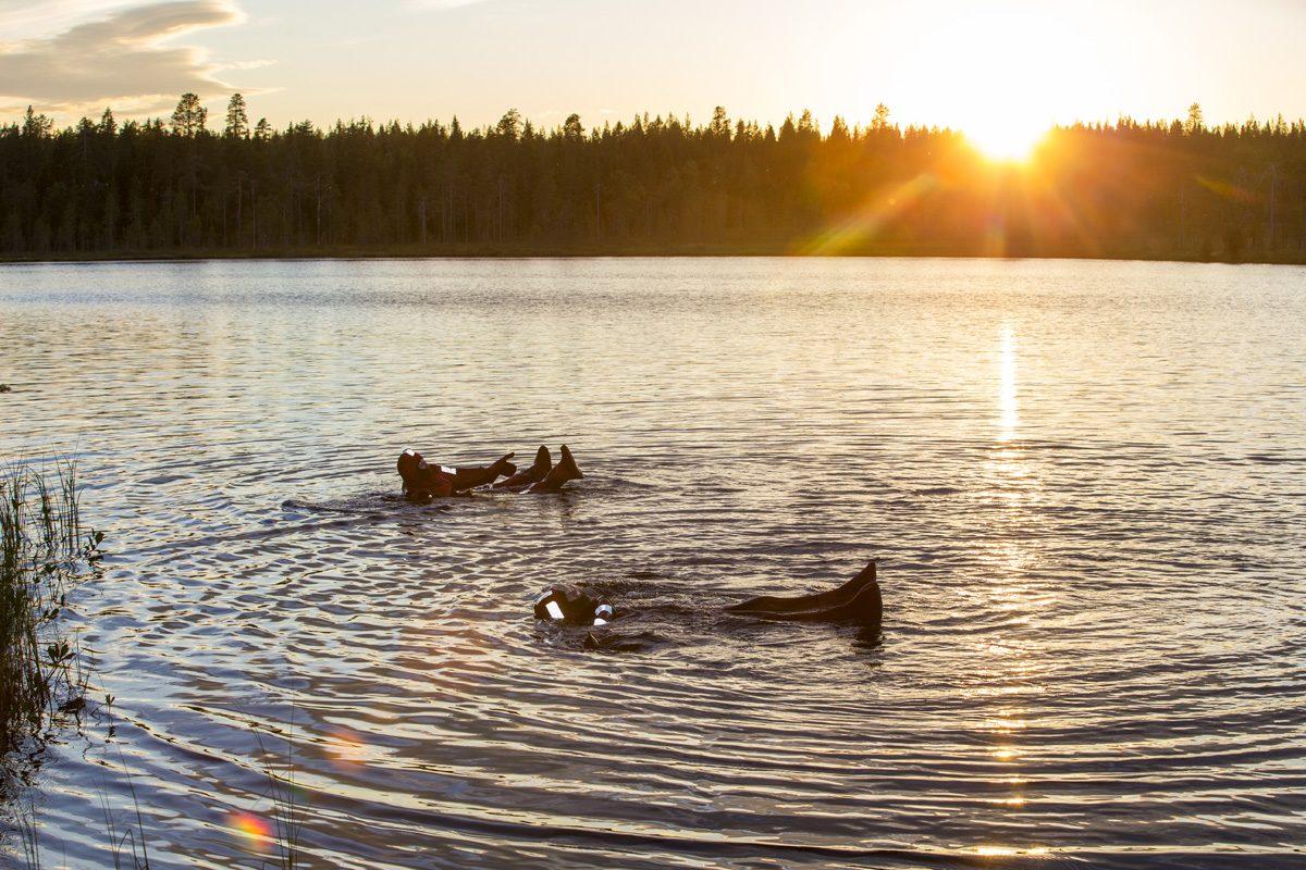 Midnight Sun Floating in Lake in Rovaniemi Rovaniemi
