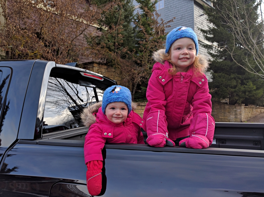 Our girls in truck bed while in Whistler Village