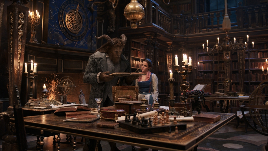 The Beast (Dan Stevens) and Belle (Emma Watson) in the castle library in Disney's BEAUTY AND THE BEAST.