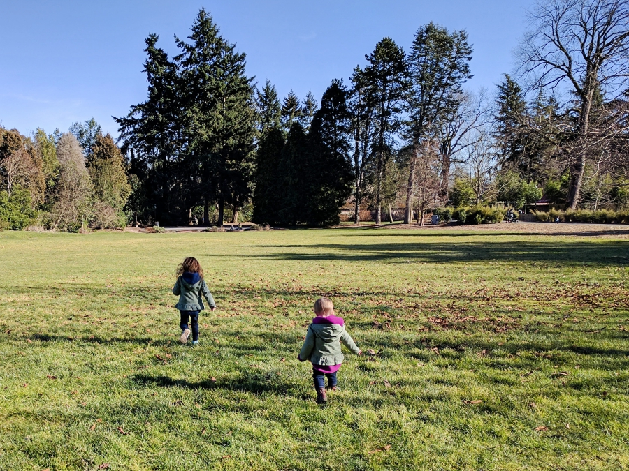Family Day: Woodland Park Zoo, running in some open green space at the zoo
