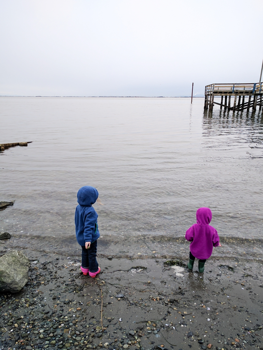 anxiety: pier stretching out to the ocean, children throwing rocks into he ocean