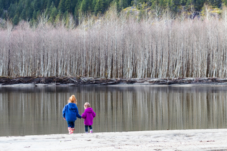 Squamish River Estuary, toddler and preschooler walking on the river bed